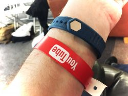 Wrist with a wristband on that's the YouTube logo